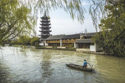 """泗泾古镇:""""等一朵花开 需要很多的耐心和微笑"""""""